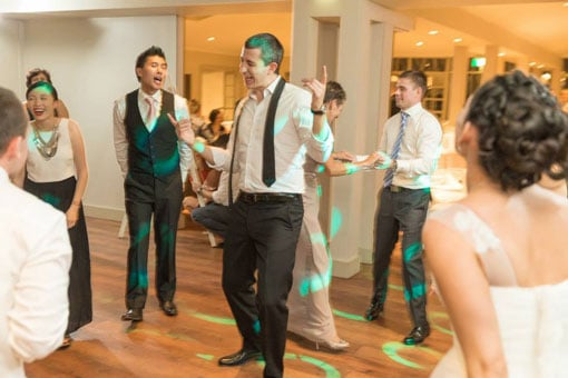 Social dancing with friends at a wedding in Sydney